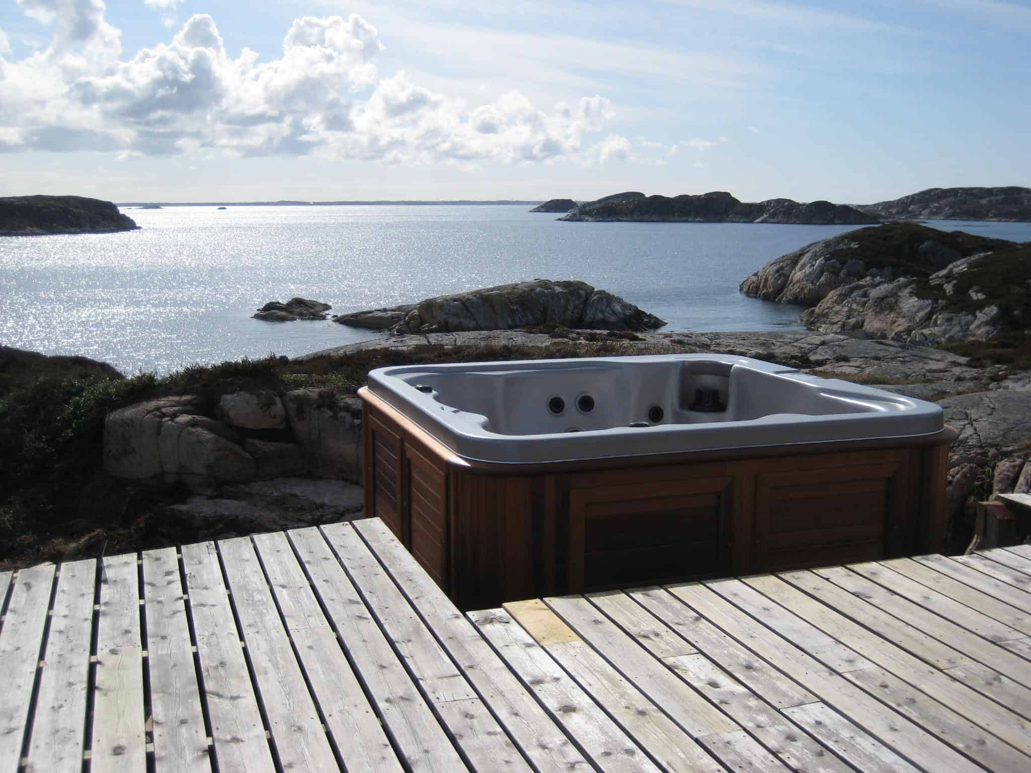 Arctic Spas Hot tub in the backyard close to a lake